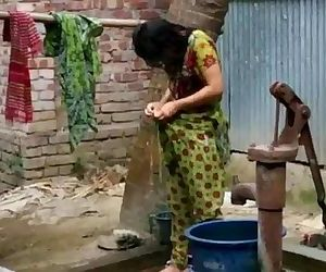 desi girl bathing outdoor..